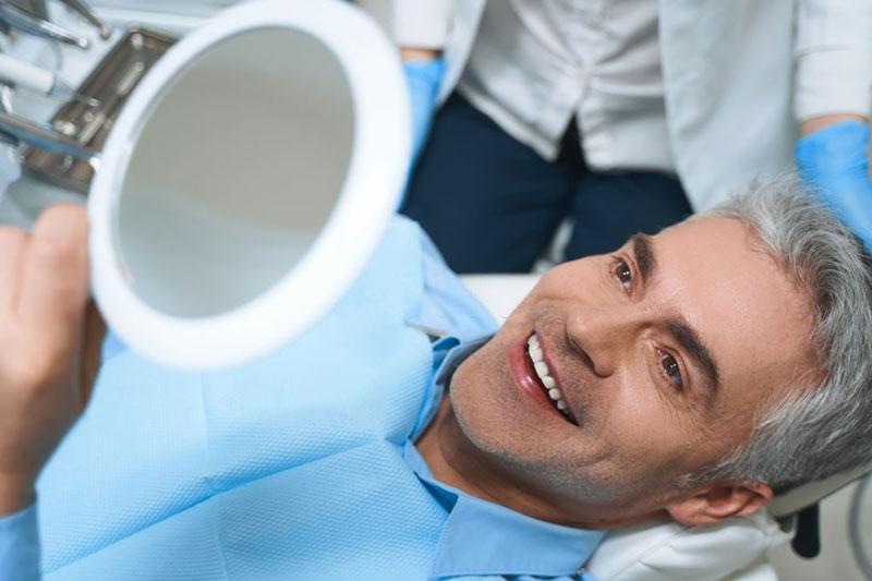 Răng Implant bên đẹp hơn các loại răng giả khác
